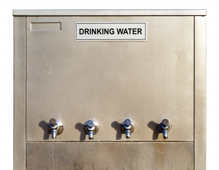 particularly: A stainless steel water-fountain with four dispenser taps is invaluable resource in hot countries, particularly the middle east