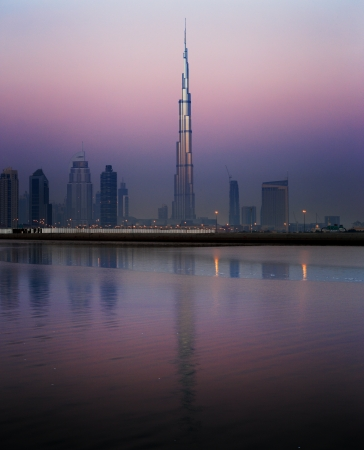 Dubai skyline as seen from Business Bay shot just before dawn  The image shows the tallest building in the world dwarfing it s neighbours Stock Photo