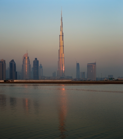 neighbours: Dubai skyline as seen from Business Bay shot just before dawn  The image shows the tallest building in the world dwarfing it s neighbours Stock Photo