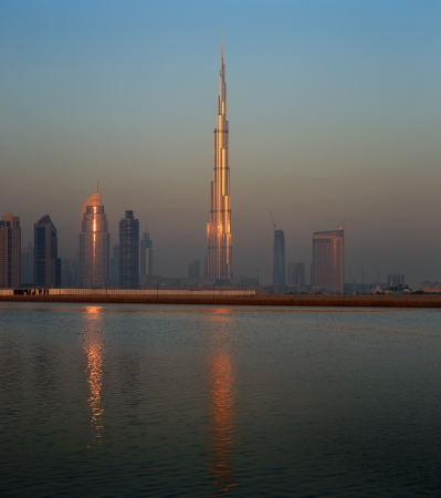 highest: Dubai skyline as seen from Business Bay shot just before dawn  The image shows the tallest building in the world dwarfing it s neighbours Stock Photo