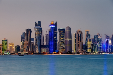 qatar: Doha, Qatar at Dusk is a beautiful city skyline of impressive contemporary architecture Editorial