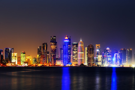 Doha, Qatar at Dusk is a beautiful city skyline of impressive contemporary architecture