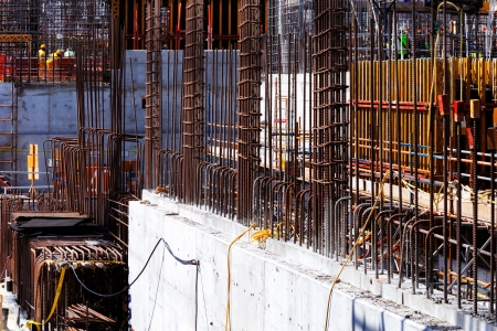 Reinforced concrete gets it s tensile strength from steel bars cast within the concrete