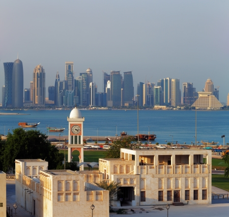 qatar: Doha, Qatar  A contrasting style of architecture can be seen each side of the bay Editorial