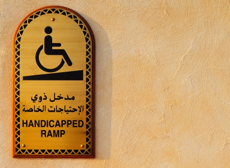 Doha, Qatar  A disabled plaque in Arabic and English at the entrance to the Mosque photo