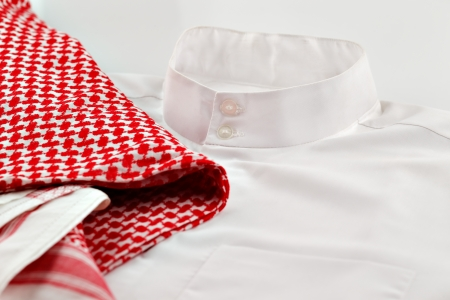 suriyah: A close up image of a thaube or Kandura together with the Ghutrah also known as the Keffiyeh  These items of clothing are usually worn by men in Arab Countries Stock Photo