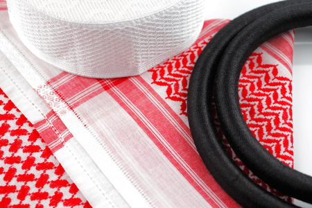 agal: A close up image of a Ghutrah also known as the Keffiyeh along with the agal and skull cap  These items of clothing are usually worn by men as a head-dress in Arab Countries