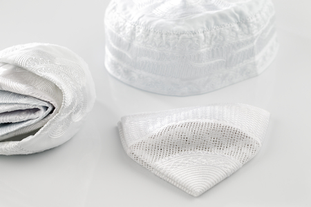 shemagh: Skull caps are usually worn by Muslim men, sometimes as a simple cap and often as an under-cap to the Ghutrah also known as the Keffiyeh