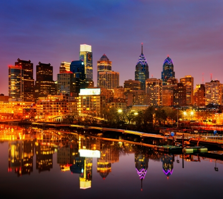 A dusk image of the City of Philadelphia, is reflected in the still waters of The Scullykill River, as seen from the South Bridge