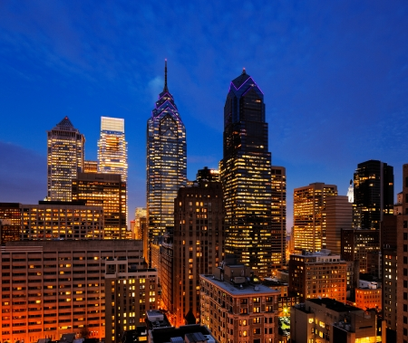 City of Philadelphia, skyline is beautifully lit up at dusk photo