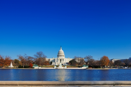 The United States Capitol building behind the Capitol Reflecting Pool in Washington DC, USA  It is the meeting place of the United States Congress, the legislature of the U S  federal government