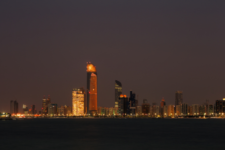 Abu Dhabi, UAE  A skyline view of the Corniche Road taken at dusk
