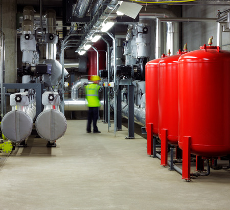 Mechanical and electrical plant rooms are are a highly sophisticated centers for efficiently controlling heating and cooling of modern buildings photo
