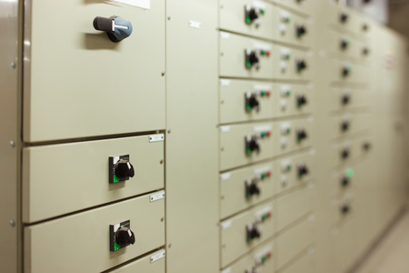 Sophisticated electrical switch gear is neatly designed in panels in the plant room Stock Photo