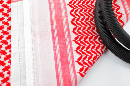 shemagh: A close up image of a Ghutrah also known as the Keffiyeh along with the agal and skull cap  These items of clothing are usually worn by men as a head-dress in Arab Countries