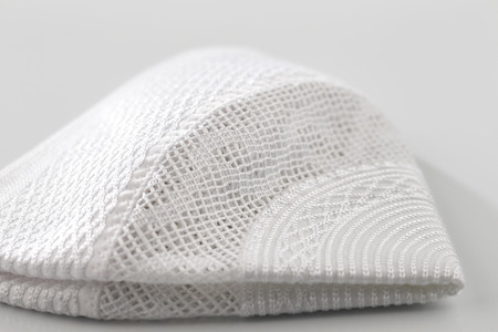keffiyeh: Skull caps are usually worn by Muslim men, sometimes as a simple cap and often as an under-cap to the Ghutrah also known as the Keffiyeh