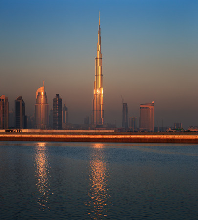 Dubai skyline as seen from Business Bay shot just before dawn  The image shows the tallest building in the world dwarfing it s neighbours