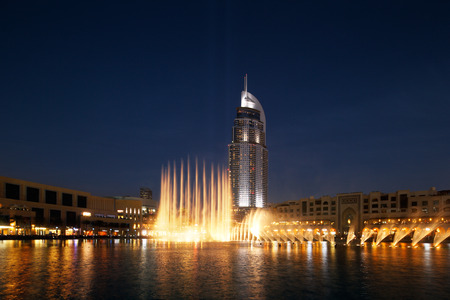 The Dubai Fountain performs and dances to the beat of the\ music, it is a spectacle to behold Dubai Mall The Address Hotel\ overlook the fountain\