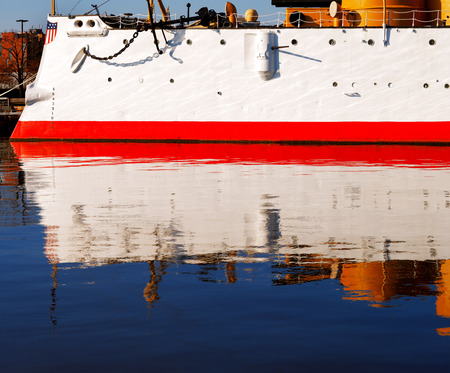 The USS Olympia stands reflective and graceful in the still waters of Penn�s Landing, City of Philadelphia photo
