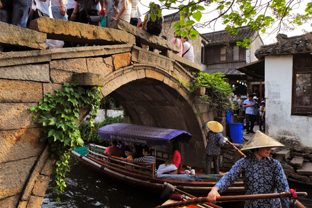 world village: Zhouzhuang is a town in Jiangsu province of China  It is one of the most famous water townships in China, noted for its profound cultural background, the well preserved ancient residential houses and the elegant watery views