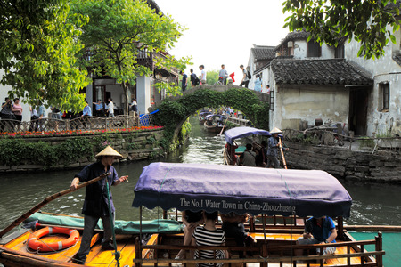 zhouzhuang: Zhouzhuang is a town in Jiangsu province of China  It is one of the most famous water townships in China, noted for its profound cultural background, the well preserved ancient residential houses and the elegant watery views