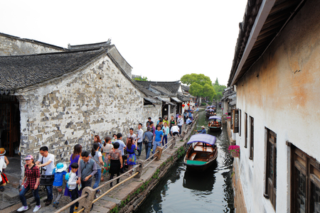 world village: Zhouzhuang is a town in Jiangsu province of China.  It is one of the most famous water townships in China, noted for its profound cultural background, the well preserved ancient residential houses and the elegant watery views