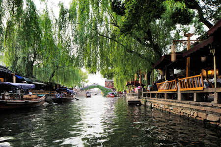 zhouzhuang: Zhouzhuang, is one of the most famous water townships in China, noted for its profound cultural background.  It has been called the  Venice of the East