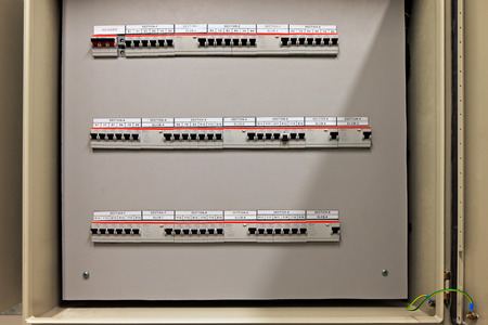 electrical panel: Fuse control panel box with a three rows of dedicated fuses. It is a crutial thing for every building to keep all the fuses well described