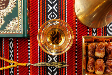 gulf: Iconic Abrian fabric is graced with symbols of Arabia, in particular Arabic tea and dates, they symbolise Arabian hospitality. Stock Photo