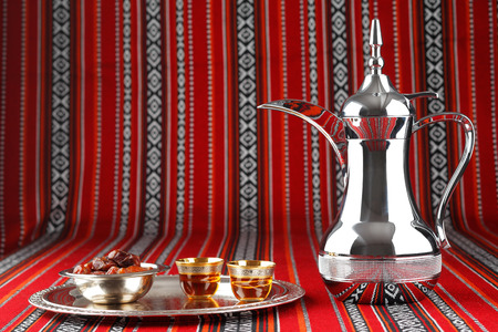 arabia: Iconic Abrian fabric is graced with symbols of Arabia, in particular Arabic tea and dates, they symbolise Arabian hospitality. Stock Photo