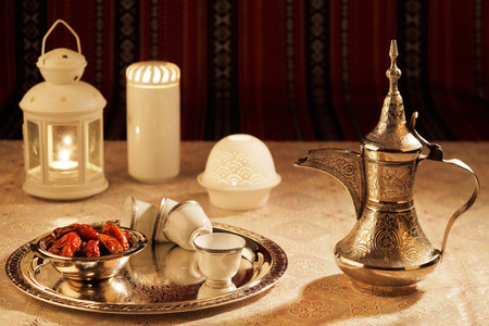 Iconic Abrian fabric is graced with symbols of Arabia, in particular Arabic tea and dates, they symbolise Arabian hospitality. Zdjęcie Seryjne