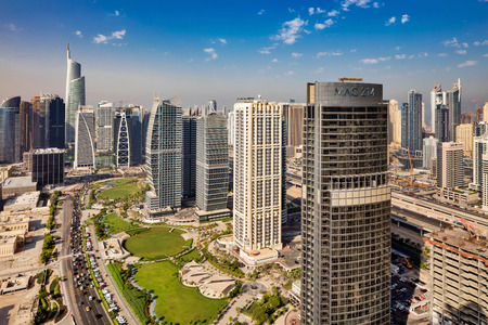 A skyline view of Jumeirah Lakes Towers, Dubai, UAE. Dubai Marina is in the background.