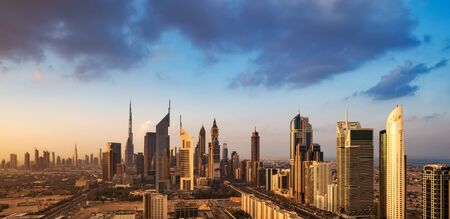 A skyline view of Dubai, UAE showing the buildings of Sheikh Zayed Road and DIFC, the financial hub of Dubai, including Emirates Towers, Burj Khalifa, Blue Tower and Chelsea Tower