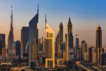 A skyline view of Dubai, UAE showing the buildings of Sheikh Zayed Road and DIFC, the financial hub of Dubai, including Emirates Towers, Burj Khalifa, DIFC and Index Building