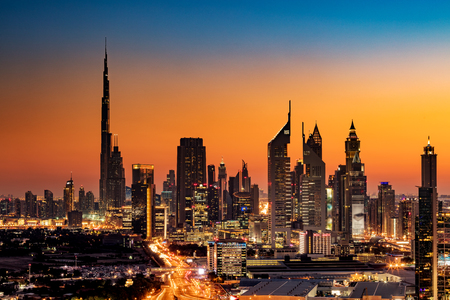biggest: A beautiful Skyline view of Dubai, UAE as seen from Dubai Frame at sunset showing Burj Khalifa, Emirates Towers, Index Building and DIFC