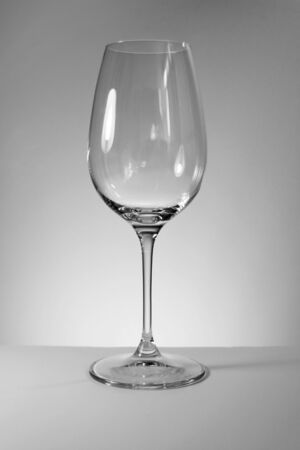Empty wine glass on a white background, black and white photography