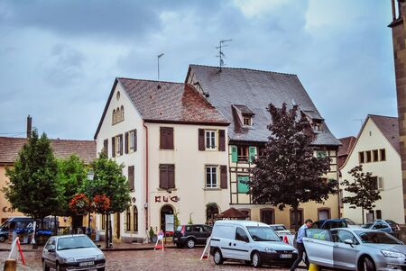 Pretty little flowery Place Clemenceau with cars, in Alsace