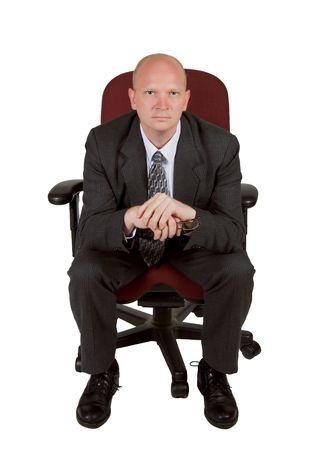 red chair: Intense businessman leaning forward in office chair
