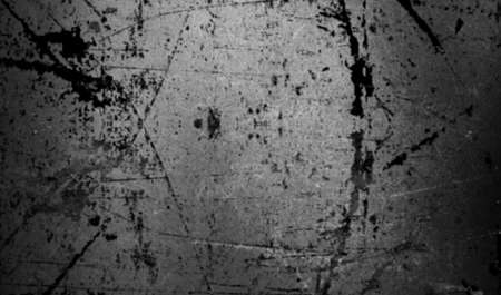 Scratched concrete wall with paint splashed. Blur effect.