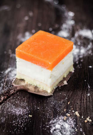 Apricot cheesecake served with powdered sugar.