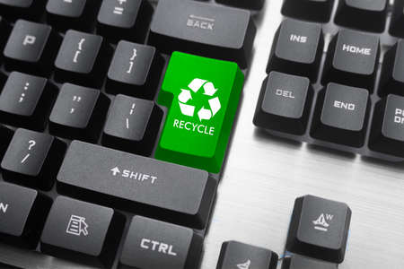 Enter key as a recycling symbol. The green color symbolizes a clean environment without pollution.
