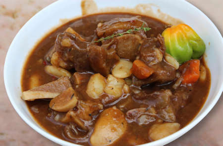 Stew cow foot soup (cow heel).  Caribbean cuisine from Jamaica. Gourmet meal.