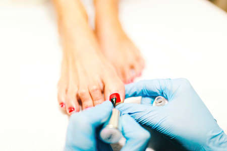 Hybrid pedicure is a technique that provides long-lasting effects of painting toenails.
