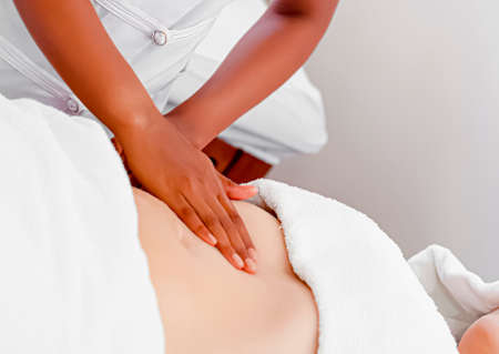 Manual lymphatic drainage is a massage based on the hypothesis that it will encourage the natural drainage of the lymph, which carries waste products away from the tissues back toward the heart. Standard-Bild