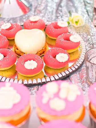 Mini donuts (Doughnuts). American cuisine. Gourmet dessert. Perfect for any occasion, incl. birthday party.