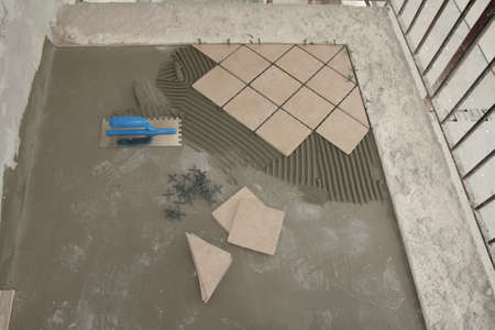 DIY! Laying outdoor ceramic tiles on the patio, balcony, terrace. The concept of single-family housing as well as interior and exterior finishing (e.g. laying ceramic tiles).