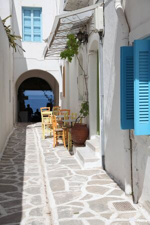 Street and terrace on Paros island (Greece) photo