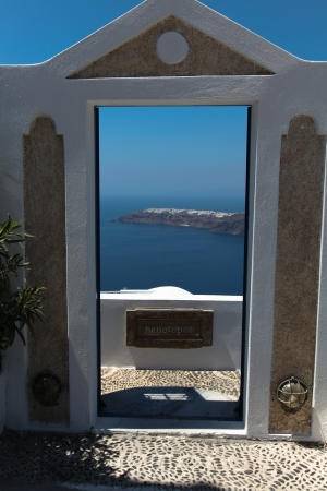 Through a door towards the oceanfront on Santorini island in the Cyclades (Greece) photo