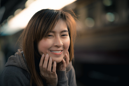 topcoat: Young woman with gently smiling Stock Photo
