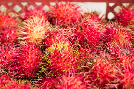 a buch of rambutan in a plastic busket Stock Photo